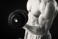 Man makes exercises dumbbells Royalty Free Stock Images