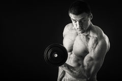 Man makes exercises dumbbells Stock Photography