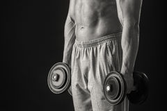 Man makes exercises dumbbells Royalty Free Stock Image