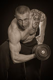 Man makes exercises dumbbells Royalty Free Stock Image