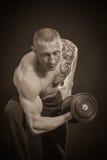 Man makes exercises dumbbells Royalty Free Stock Photos