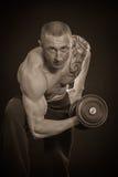 Man makes exercises dumbbells Stock Photo