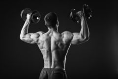 Man makes exercises dumbbells Royalty Free Stock Photo