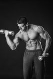 Man makes exercises dumbbells. Sport, power, dumbbells, tension, exercise. Article about fitness and sports.Gym and fitness concept - bodybuilder and dumbbell royalty free stock images