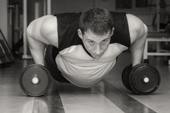 Man makes exercises dumbbells. Sport, power, dumbbells, tension, exercise. Article about fitness and sports.Gym and fitness concept - bodybuilder and dumbbell stock images