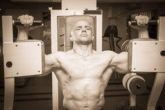 Man makes exercises Stock Images
