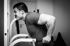 Man makes exercises Stock Photography