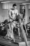 Man makes exercises Stock Photos