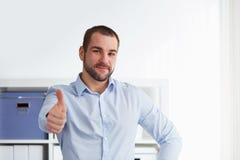 Man makes a gesture thumb up Stock Image