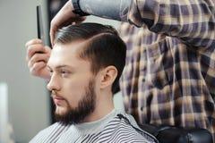 Man makes a haircut at barbershop Stock Photography