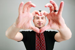 Man makes the heart using fingers Royalty Free Stock Image