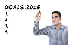 Man makes his goals in 2015. Smiling asian person uses marker to write his goals in 2015 Stock Images