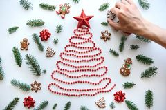 Man makes his own creative Christmas or New Year tree. royalty free stock images