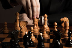 Man makes a move chess figure Royalty Free Stock Photos