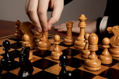 Man makes a move chess figure Stock Images
