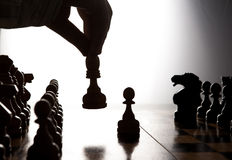 Man makes a move chess figure Royalty Free Stock Image