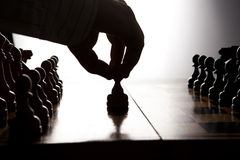 Man makes a move chess figure Royalty Free Stock Images