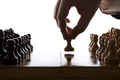 Man makes a move chess pawn Stock Image
