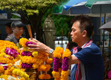 Man Makes Offering at Erawan Hindu Shrine in  Bangkok. Stock Photography