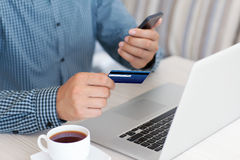 Man makes the payment by credit card on the laptop Royalty Free Stock Photography