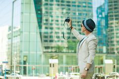 Man makes photo shoot of skyscrapers in the big city. Travel and lifestyle concept. Royalty Free Stock Photography