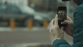 Man makes the photo on your smartphone stock video footage