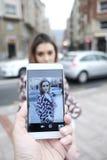 Man makes photos of beautiful woman Stock Images