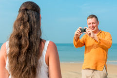 Man makes a picture of  girlfriend Royalty Free Stock Photography