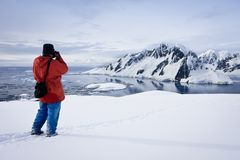 Man makes a picture. Of mountains in Antarctica Royalty Free Stock Photography