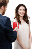 Man makes present to his girlfriend Stock Images