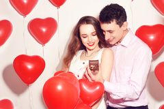 Man makes present to his lovely sweetheart girl. Lover`s valentine day. Valentine Couple. Boy gives to his girlfriend jewelry. stock images