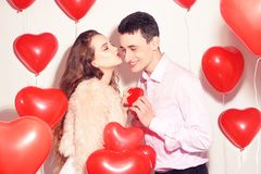 Man makes present to his lovely sweetheart girl. Lover`s valentine day. Valentine Couple. Man gives to his girlfriend sweets stock photos