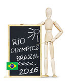 Man makes presentation about Olympic Games in Rio 2016. Abstract conceptual image with a wooden puppet Stock Photo