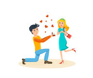 Man makes proposal to his beloved, girl delighted with surprise. Royalty Free Stock Photo