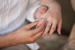 Man makes proposal to a woman. Young man puts ring on finger of girl Royalty Free Stock Photo