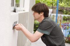 Man makes renovation Royalty Free Stock Images