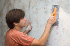 Man makes renovation indoor Stock Images