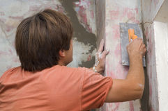 Man makes renovation indoor Royalty Free Stock Photos