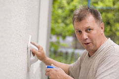 Man makes renovation outdoor Stock Image