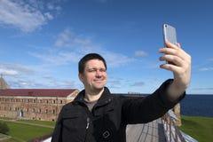 Man makes selfie Royalty Free Stock Photo