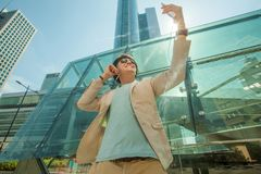Man makes selfie in the big city against the background of skyscrapers. Travel and life style concept. Stock Photos