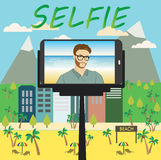 Man makes selfie using a monopod and a smartphone Royalty Free Stock Images