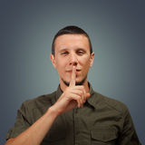 Man makes silence gesture Stock Images