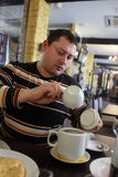 Man makes the tea Royalty Free Stock Photos