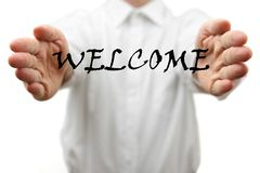 Man makes a welcome gesture with welcome word Royalty Free Stock Photography
