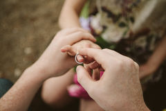 Man makes woman offer get engaged Stock Image