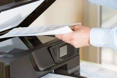 Free Man Making A Photocopy Stock Photography - 39283602