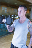 Man making alternate curl - workout routine stock photos