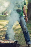 Man making barbecue in the park Stock Photos