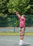 Man after making a basketball shot Stock Photos